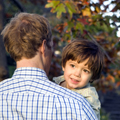 dad and boy with leaves